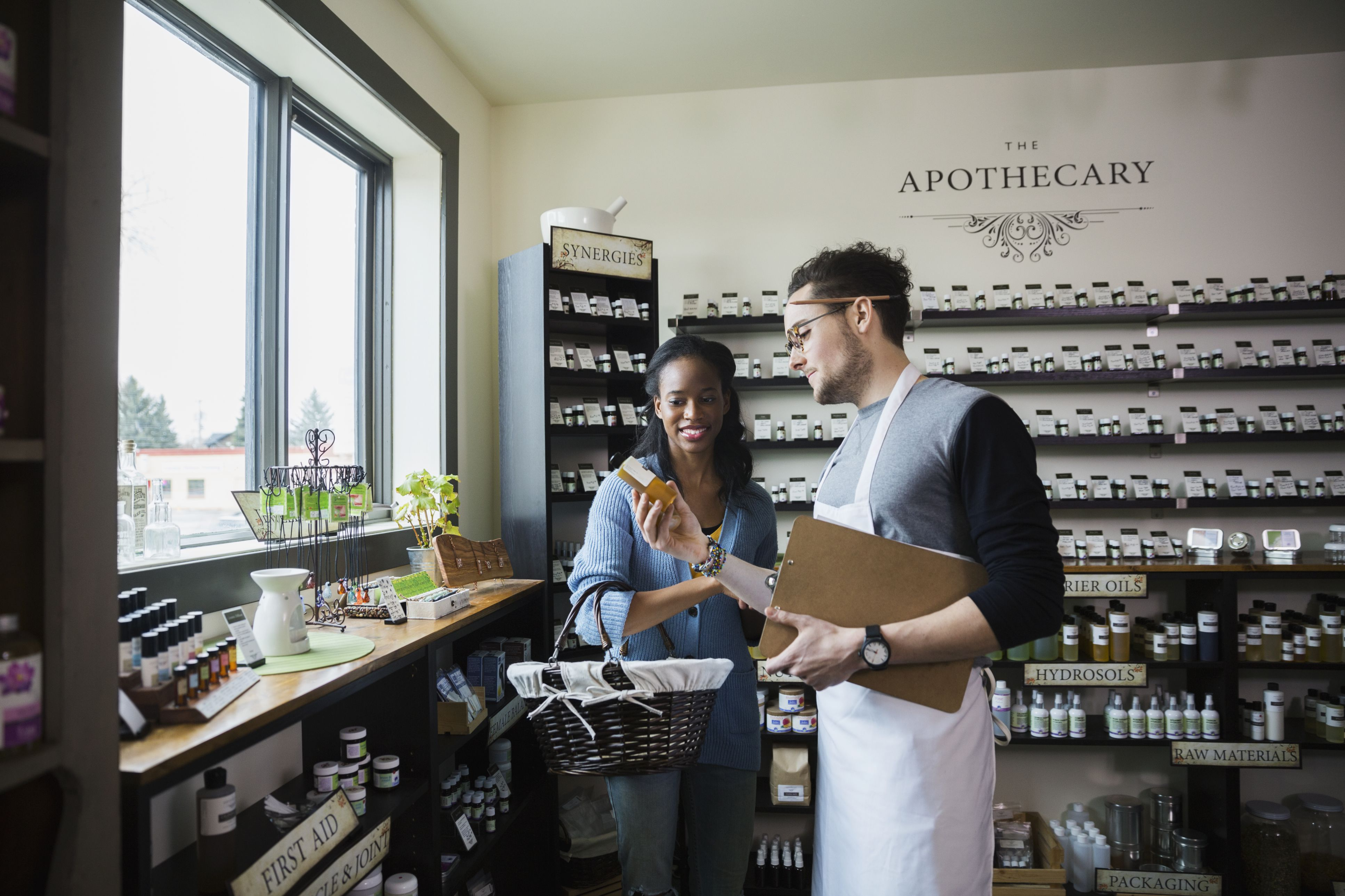 a man and woman in an apothecary shop