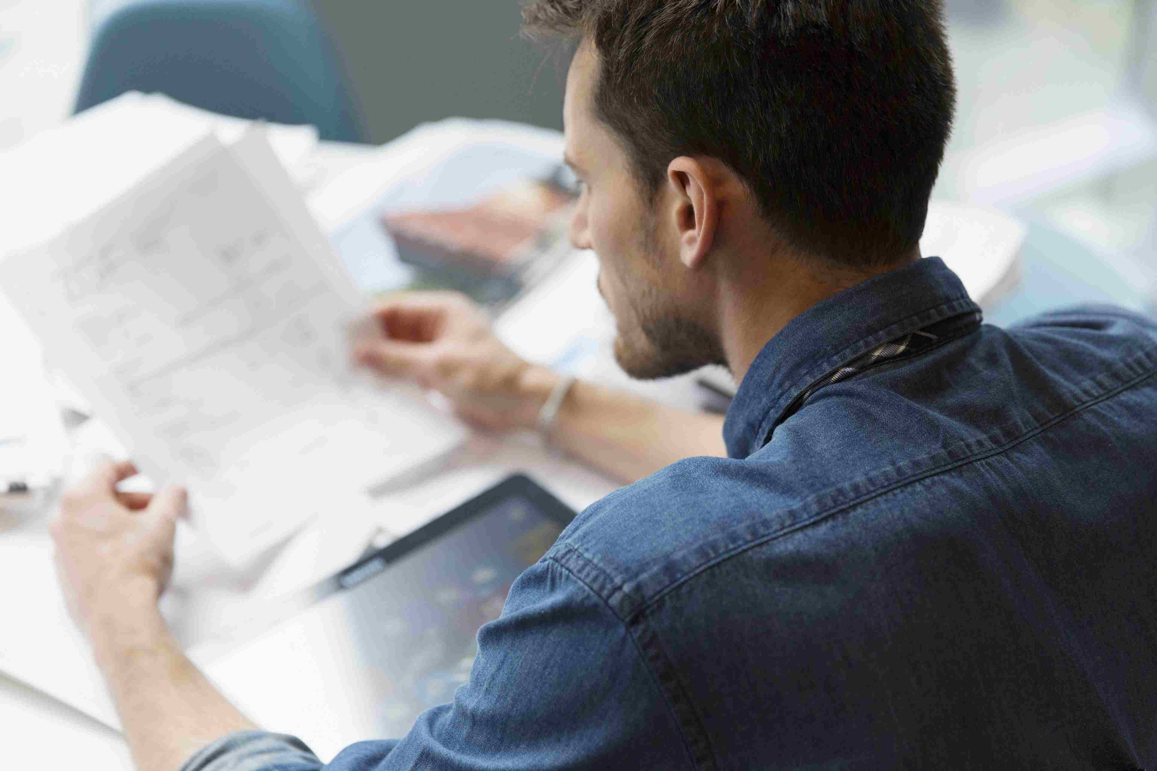 Man reviewing paperwork to register his business