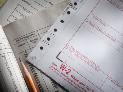 A blank W-2 form and accompanying instructions.