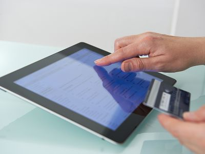 Tablet being used to process a credit card payment