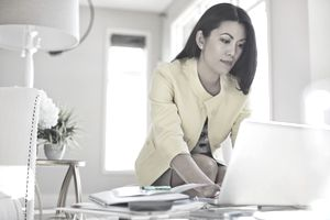 Woman working on finances with her computer.