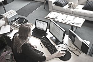 Overview of woman working at home