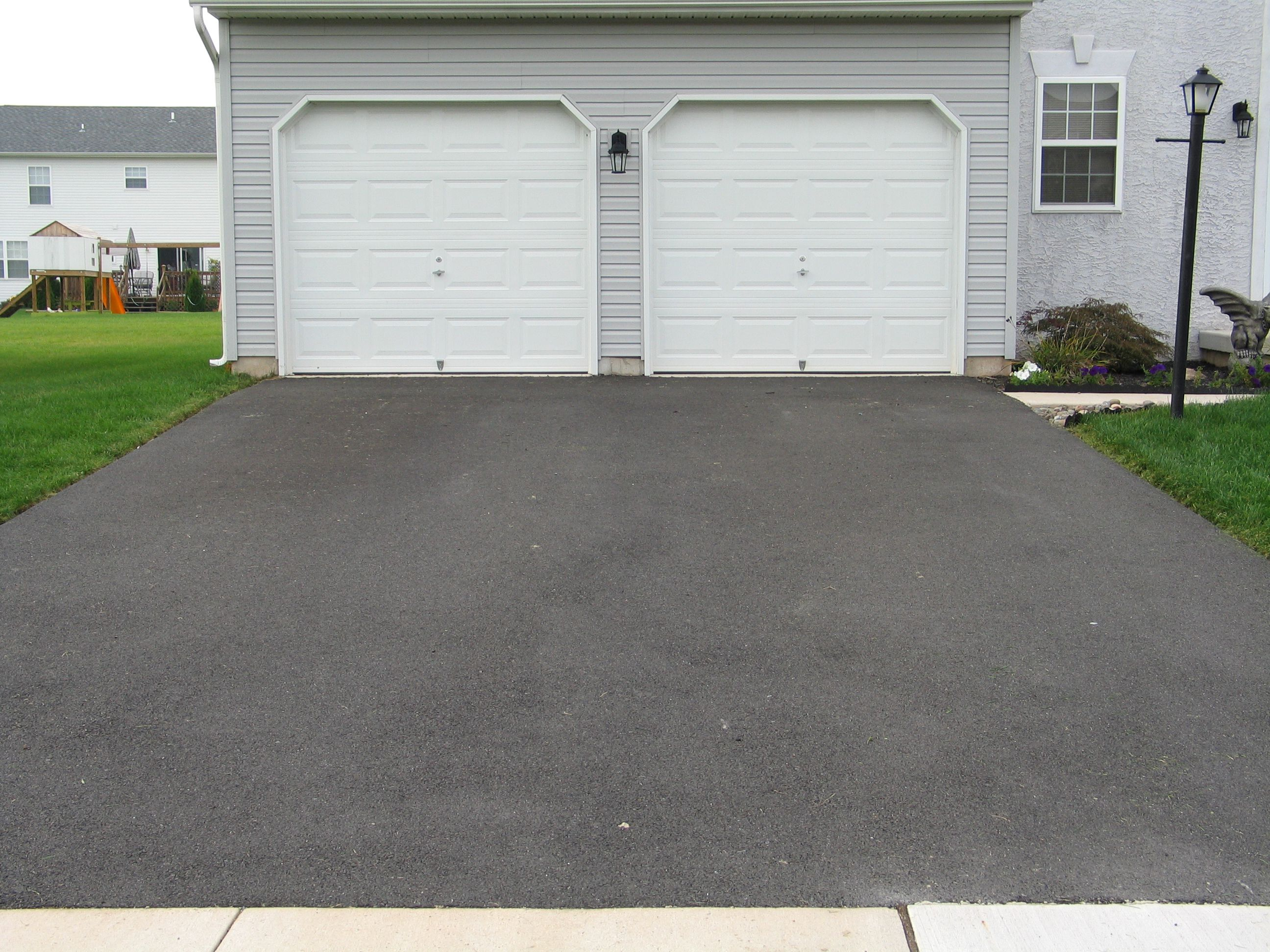 Seal Coating Asphalt Pavement: Benefits, Costs, Tips
