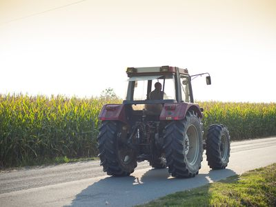 Tractor Driving on Rural Road