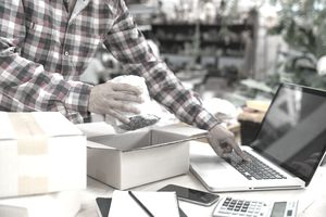 Shipping shopping online, young start up small business owner writing address