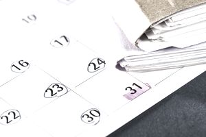 a calendar with file folders on it and dates circled leading up to a deadline on the last day of the month