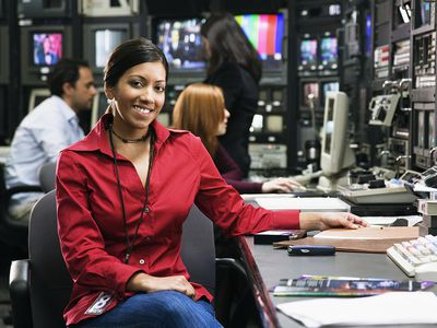 Woman reporter in a newsroom.