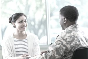 Young woman talks with recruitment officer