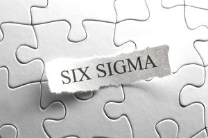 Six Sigma printed on puzzle