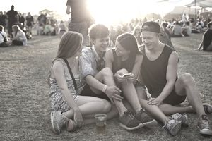 Group of friends hanging out on a grassy field