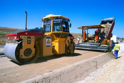 The base course or underlayer is placed by a paving machine