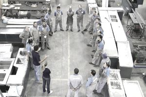 warehouse workers listening to manager