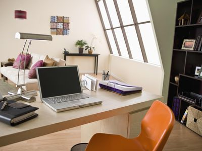 Home office in separate area of living room, which qualifies for tax deduction for home business