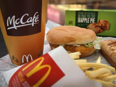 DES PLAINES, IL - OCTOBER 24: In this photo illustration, a McChicken sandwich sits with typical Dollar Menu items sold at a McDonald's restaurant on October 24, 2013 in Des Plaines, Illinois. McDonald's has announced it will make changes to its low-priced Dollar Menu, which includes items like coffee, small fries, hamburgers and apple pies. The new menu, dubbed the Dollar Menu and More, will offer some higher priced options such as the grilled Onion Cheddar Burger and a McChicken sandwich.