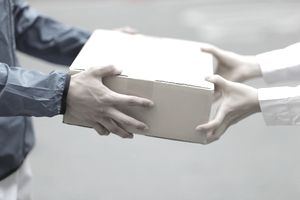 Delivery person with packages,close up