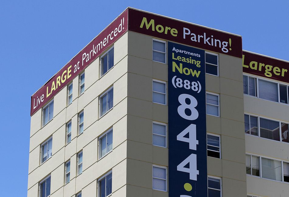A lease sign posted on one of the towers at an apartment complex in San Francisco, California.
