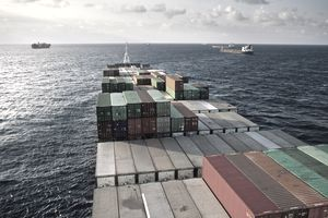 Containers of commodities on a cargo ship at sea