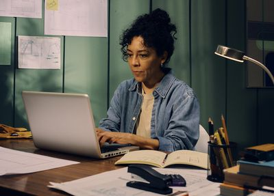 women sitting at her desk on her computer