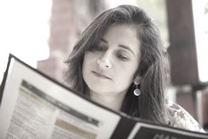 Hispanic woman looking at restaurant menu