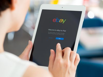 a person pulling up eBay on tablet
