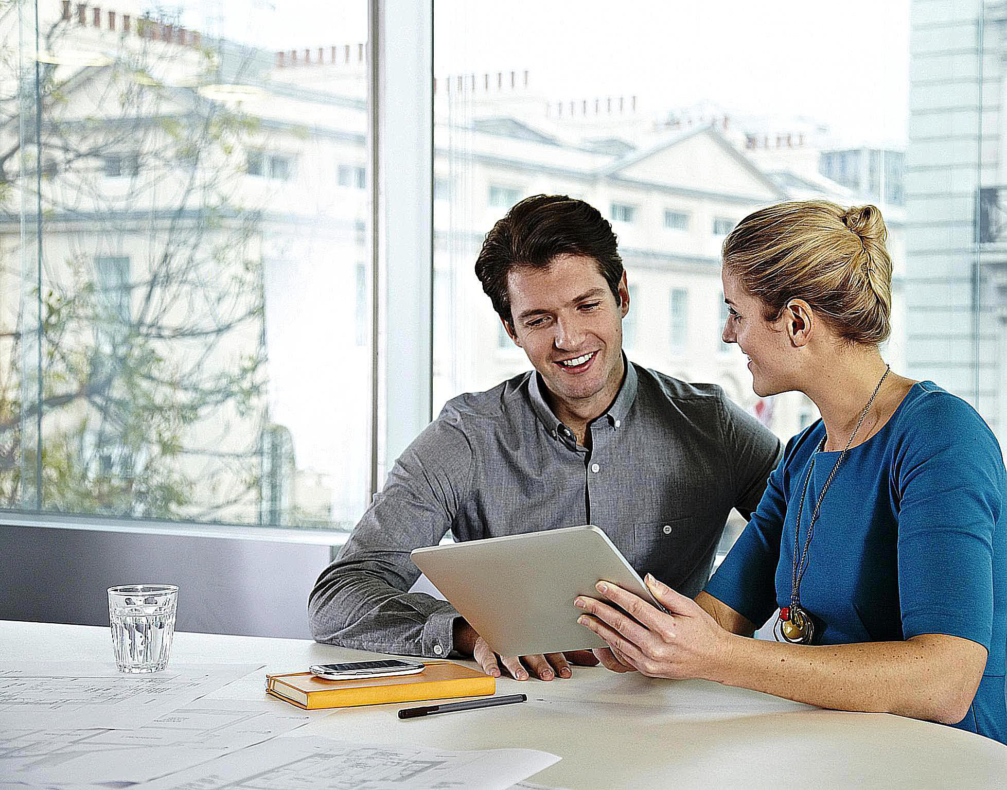 Man and woman working together on a tablet