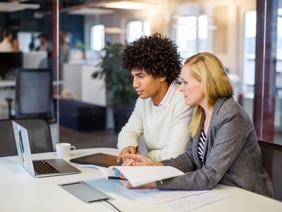 Business partners working together in office