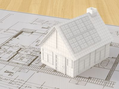 bluprint with 3-d model of house on it.