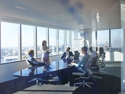 Young Entrepreneur Presenting Project in Exclusive Boardroom