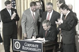 U.S. President George W. Bush signs the Corporate Reform Bill in 2002.
