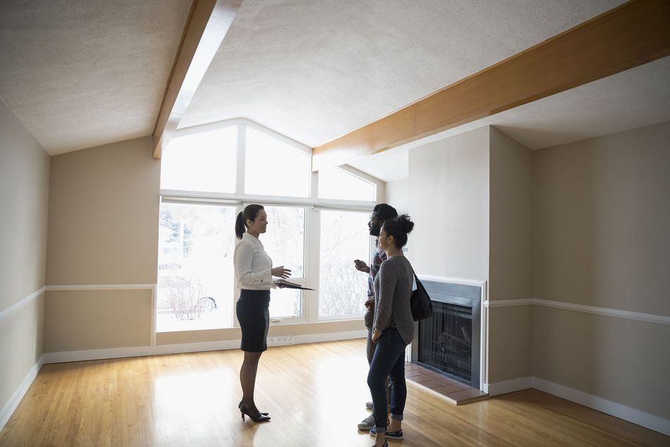 Real Estate Agent Showing an Empty House to Couple