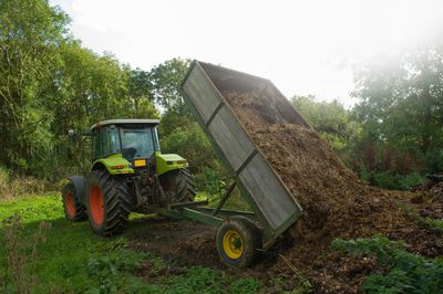 tractor dumping manure