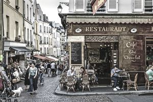 Busy corner bistro in the Saint Medard District in Paris, France
