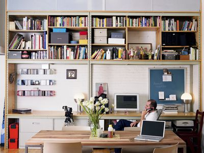 Man using mobile phone in home office