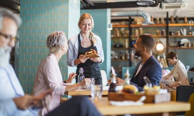 Customers talking to a restaurant owner