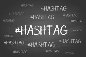 The word hashtag written on a chalkboard