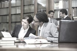 Lawyers talking in a research library