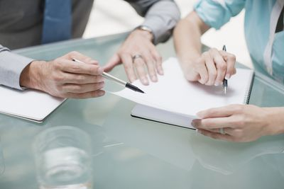 Two people drafting a proposal.