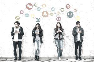Young people on their phones with social media icons over their head