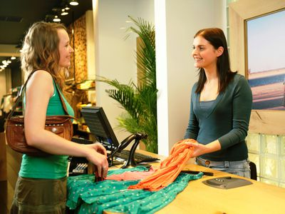 Woman checking out at clothing store
