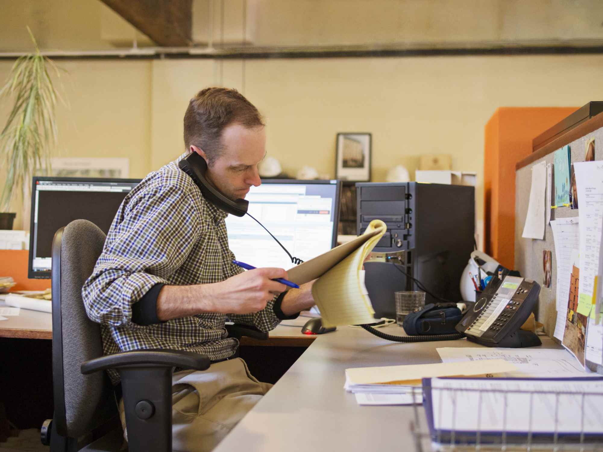 Man in office on the phone
