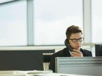 Businessman talking on phone in office