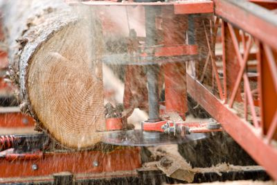 Close up of a saw mill cutting a log.