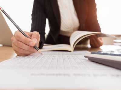 person writing in ledger