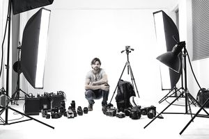A photographer surrounded by photography equipment