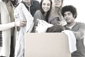 a group of young people putting close in a box