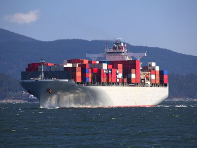 Large cargo container ship sailing into port.