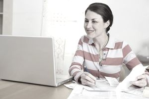 Smiling woman doing taxes
