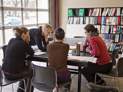 Business meeting with four women around a conference table