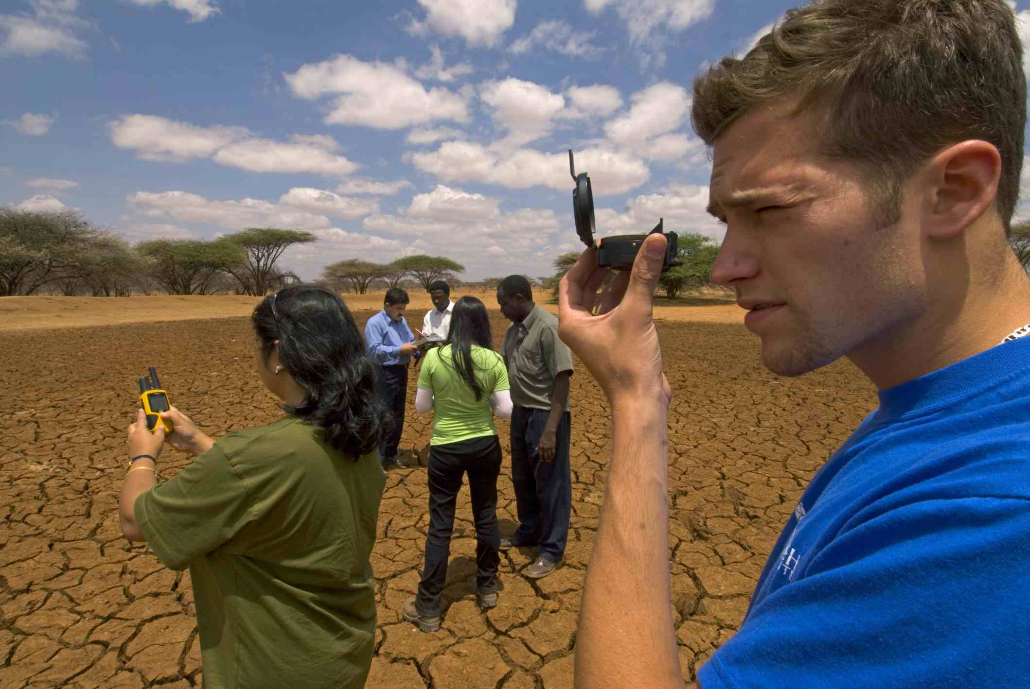 Volunteers conducting water conservation survey at a dry waterhole on an Earthwatch Expedition, Lewa Conservancy, Kenya.