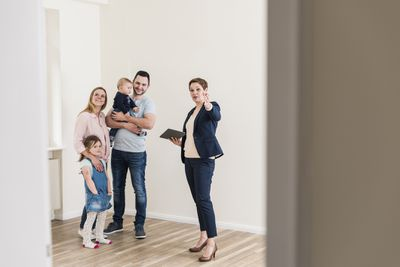 Property manager showing a home to a 4-person family